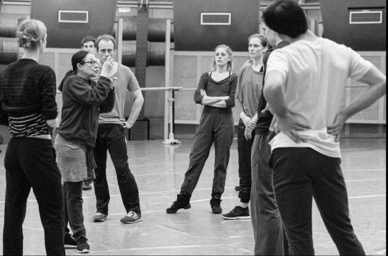 Marin instructs dancers copy